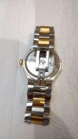 Relógio marca baume mercier modelo Riviera aço ouro