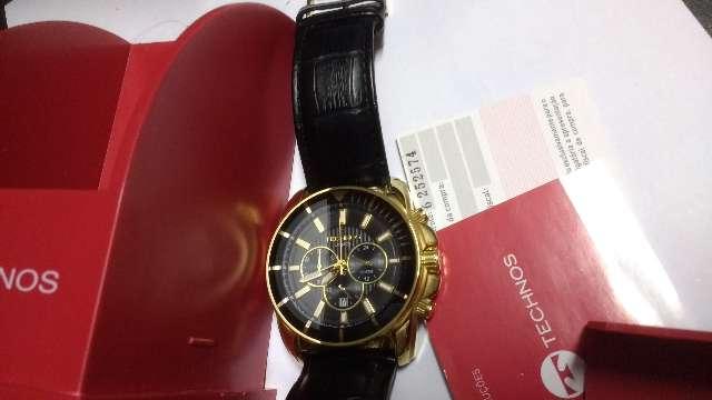 Relógio marca tecnico dourado quartsz crono